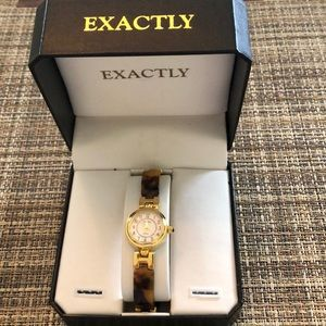Exactly gold tone and tortoise shell watch